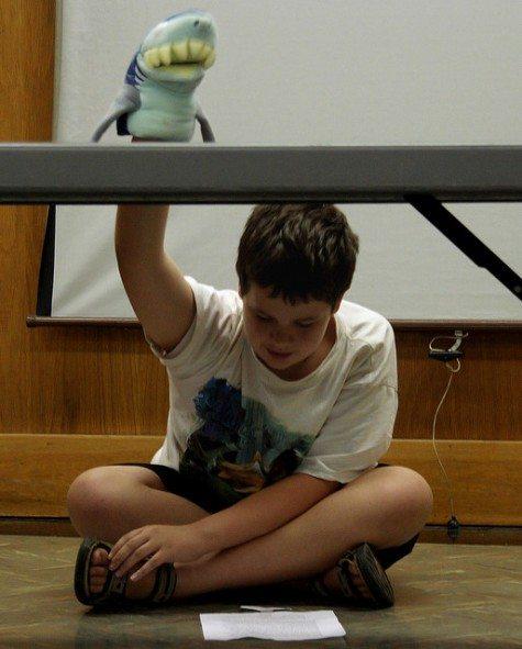 Boy with shark puppet