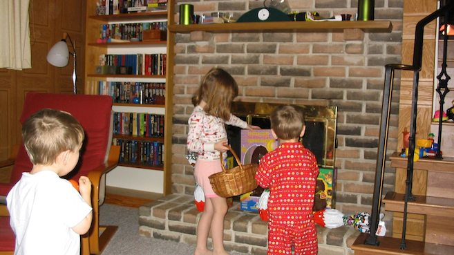 Made to make for an interesting childhood? Fireplace with glass doors, brick hearth, stairs with wrought iron bannisters (just the right space to stick a three year-old head through). Photo by Brad Moon