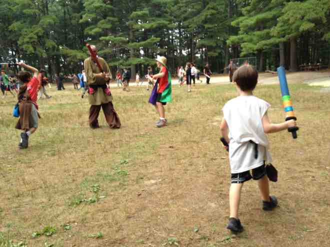 A boy sees his opening and makes his move on the field of battle at the Wizards & Warriors Summer Camps and Adventures  (Photo: Ethan Gilsdorf)