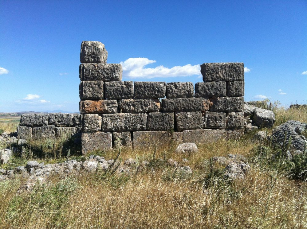 Tower and clouds: a ruined guard tower of the city walls of Plataea (Image: Noble Smith)