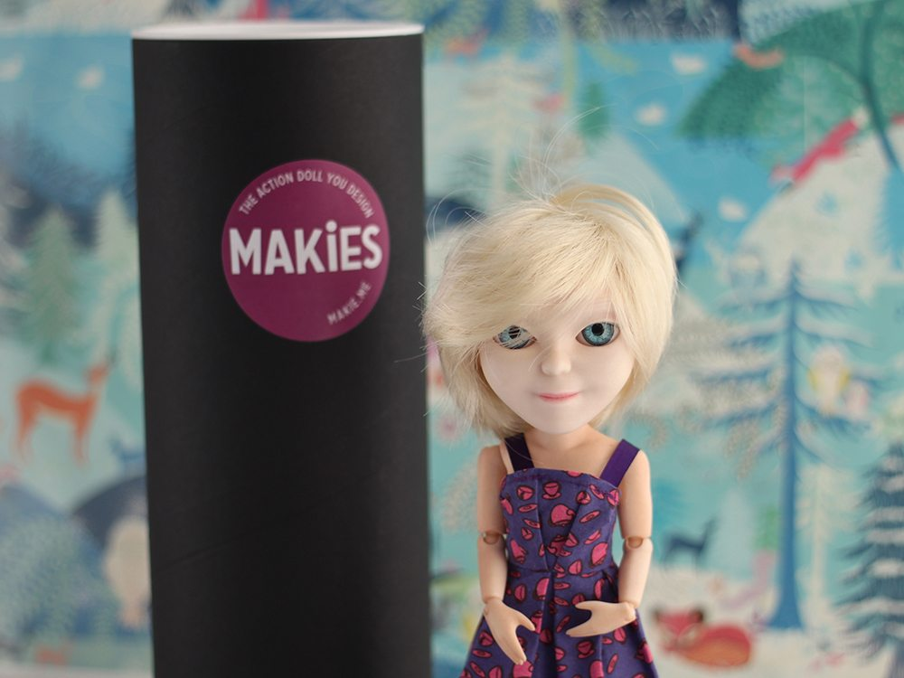 The Makie doll with her delivery tube
