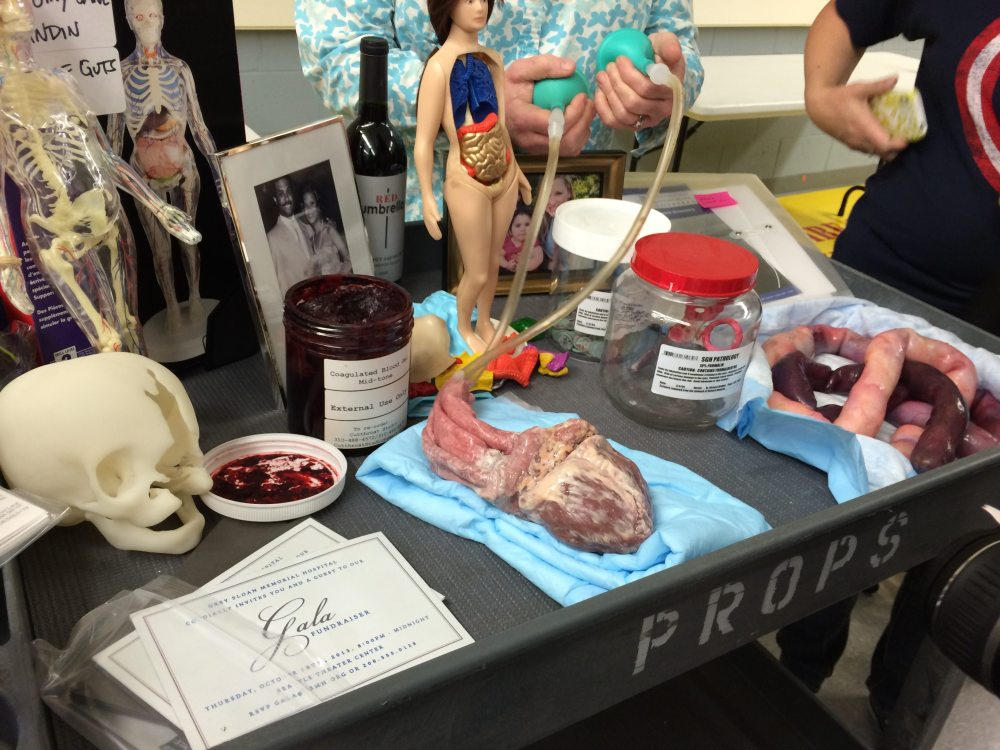 Props, including a beating heart (note the person handling the air bulbs)