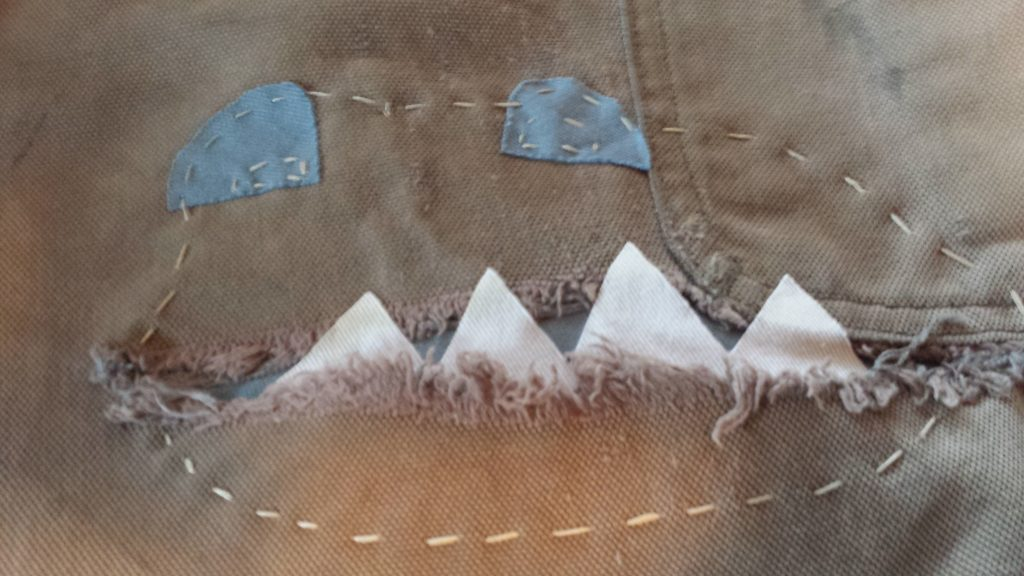 Hand sewing to ensure patches stay in place. (image: L. Weldon)