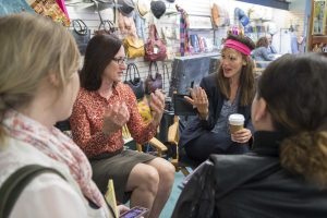 """Lisa Henson and Jennifer Garner (wearing a headband to create the appearance of extreme """"helmet hair"""") answer questions from a group of bloggers."""
