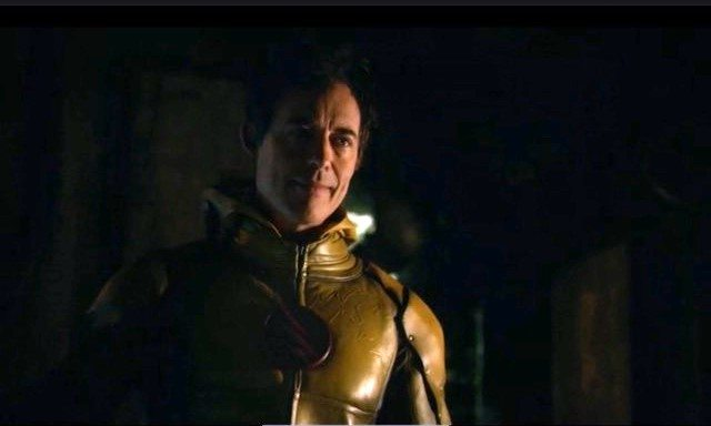 Either way, we finally get to see him in the suit. Source: CW.