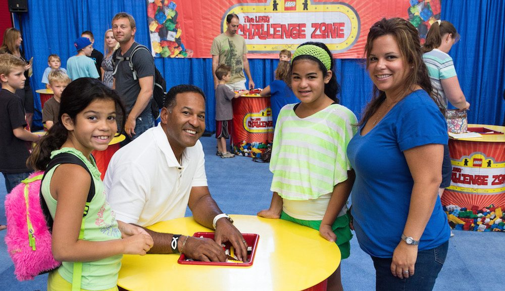A family taking part in the LEGO Challenge Zone.