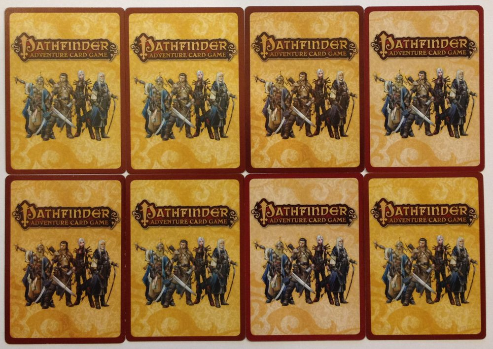 Card backs from multiple print runs showing the variety.