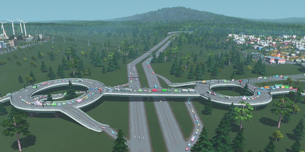 Two elevated roundabouts flanking a highway.