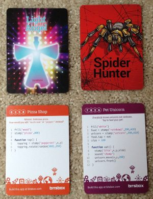 Four Bitsbox trading cards, two showing the art side, two showing the side with code.