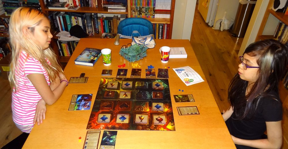 Playing a 3-player game of Apotheca with my kids. Photo: Jonathan H. Liu
