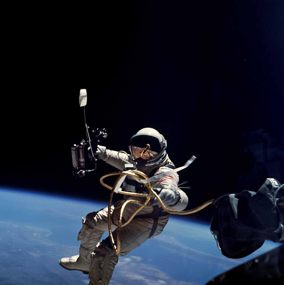 Ed White performing the first American spacewalk. Image in public domain.