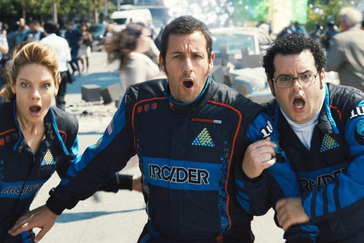 PIXELS - 2015 FILM STILL - Pictured: Violet (Michelle Monaghan), Sam Brenner (Adam Sandler), Ludlow (Josh Gad) and Q*bert - Photo Credit: George Kraychyk © 2015 CTMG, Inc. All Rights Reserved. **ALL IMAGES ARE PROPERTY OF SONY PICTURES ENTERTAINMENT INC. FOR PROMOTIONAL USE ONLY. SALE, DUPLICATION OR TRANSFER OF THIS MATERIAL IS STRICTLY PROHIBITED.