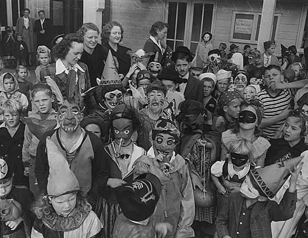 Children in Halloween costumes at high Point, Seattle in 1943 by IMLS Digital Collections and Content on Wikipedia via Flickr. (CC-by-2.0)