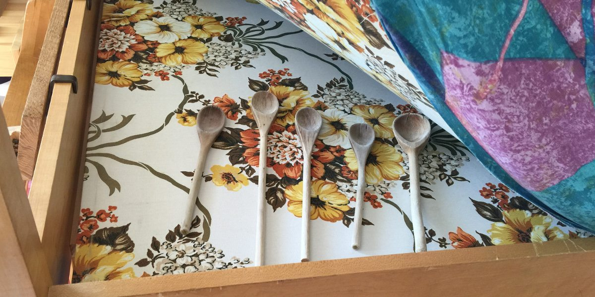 Wooden spoons on my childhood bed, just as I hid them to avoid a spanking.