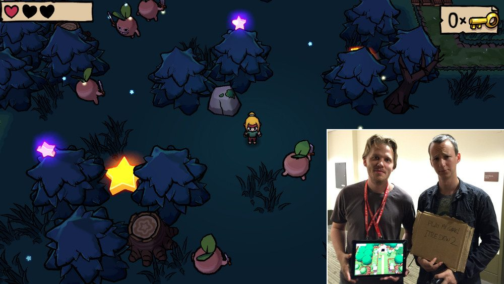 Screenshot of a night time scene from Ittle Dew 2 with an inset showing a two men, one with a tablet around his neck showing a different scene from the same game.