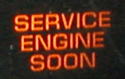 """""""Check-Engine-Light"""" by IFCAR - Own work. Licensed under Public Domain via Commons - https://commons.wikimedia.org/wiki/File:Check-Engine-Light.jpg#/media/File:Check-Engine-Light.jpg"""