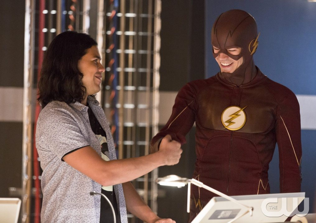 "The Flash -- ""Family of Rogues"" -- Image FLA203a_0017b.jpg -- Pictured (L-R): Carlos Valdes as Cisco Ramon and Grant Gustin as The Flash -- Photo: Jeff Weddell/The CW -- �© 2015 The CW Network, LLC. All rights reserved."