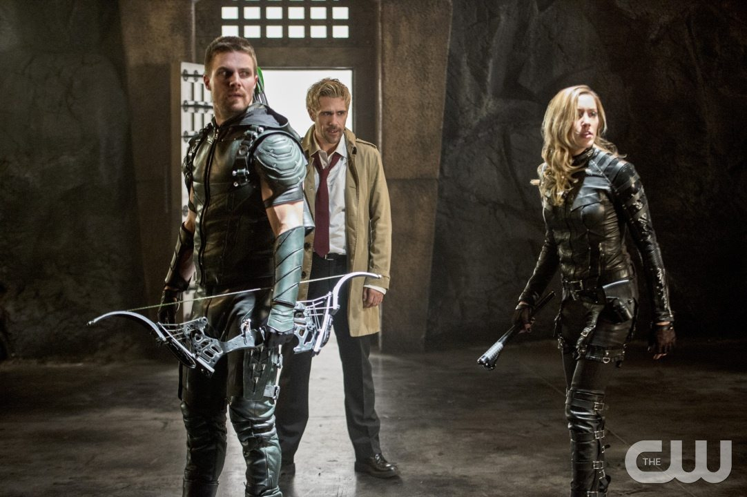 """Arrow -- """"Haunted"""" -- Image AR404B_0241b.jpg -- Pictured (L-R): Stephen Amell as The Arrow, Matt Ryan as Constantine and Katie Cassidy as Black Canary -- Photo: Cate Cameron/ The CW -- �© 2015 The CW Network, LLC. All Rights Reserved."""