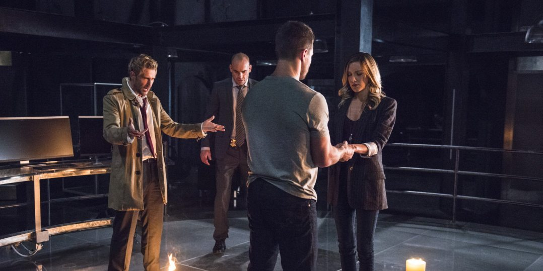 """Arrow -- """"Haunted"""" -- Image AR404B_0027b.jpg -- Pictured (L-R) Matt Ryan as Constantine, Paul Blackthorne as Detective Quentin Lance, Stephen Amell as Oliver Queen and Katie Cassidy as Laurel Lance -- Photo: Cate Cameron/ The CW -- �© 2015 The CW Network, LLC. All Rights Reserved."""