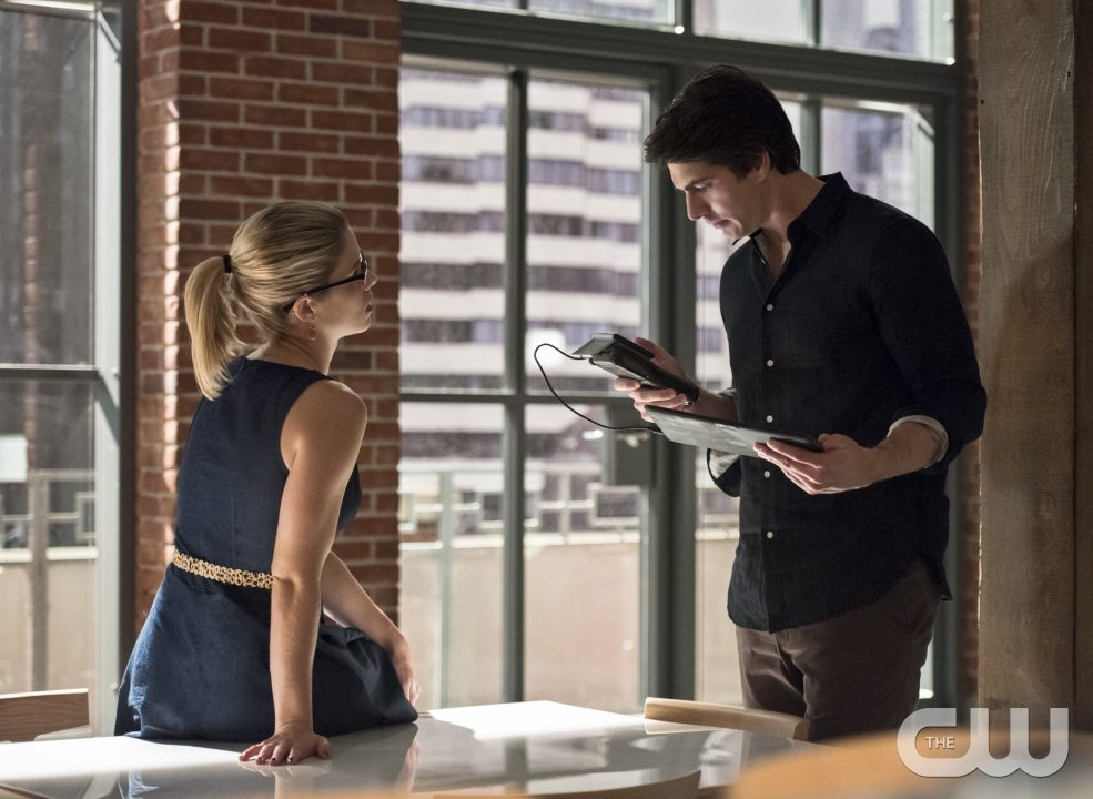 """Arrow -- """"Brotherhood"""" -- Image AR407A_0142b.jpg -- Pictured (L-R): Emily Bett Rickards as Felicity Smoak and Brandon Routh as Ray Palmer -- Photo: Dean Buscher/The CW -- �© 2015 The CW Network, LLC. All Rights Reserved."""