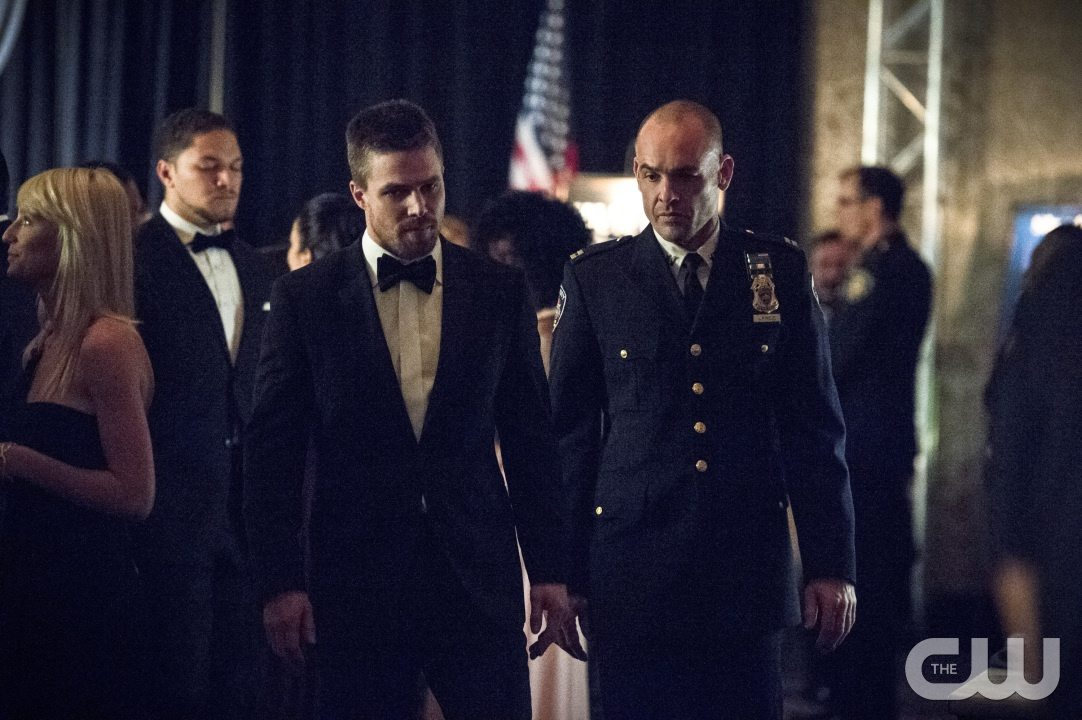 """Arrow -- """"Brotherhood"""" -- Image AR407B_106b.jpg -- Pictured (L-R): Stephen Amell as Oliver Queen and Paul Blackthorne as Detective Quentin Lance -- Photo: Cate Cameron/The CW -- �© 2015 The CW Network, LLC. All Rights Reserved."""