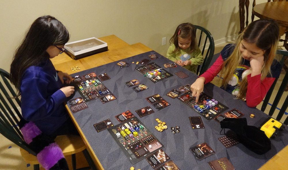 My kids tried out Roll Player and enjoyed it, though the toddler's strategy was pretty weak. (Prototype shown) Photo: Jonathan H. Liu
