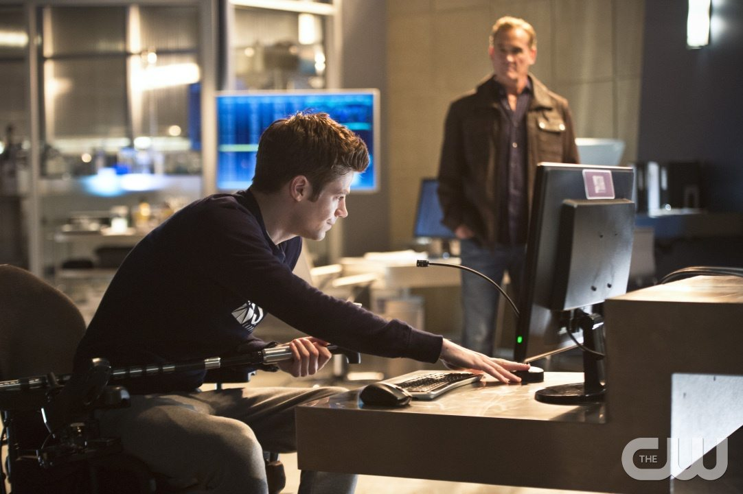 """The Flash -- """"Gorilla Warfare"""" -- Image FLA207B_0052b.jpg -- Pictured (L-R): Grant Gustin as Barry Allen and John Wesley Shipp as Henry Allen -- Photo: Cate Cameron/The CW -- �© 2015 The CW Network, LLC. All rights reserved."""