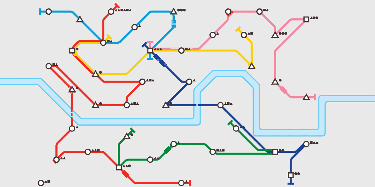 A late-game-stage screenshot from Mini Metro showing six differently colored routes, two dozen stops, and a river bisecting the screen horizontally.