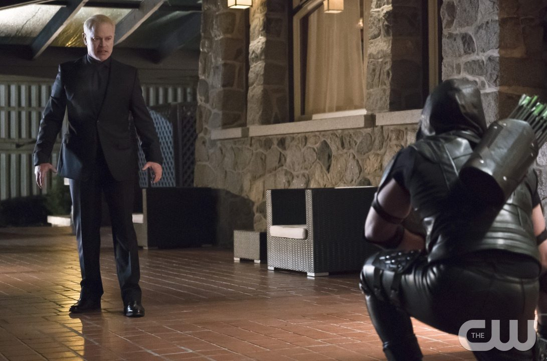 """Arrow -- """"Blood Debts"""" -- Image AR410a_0200b.jpg -- Pictured (L-R): Neal McDonough as Damien Darhk and Stephen Amell as The Arrow -- Photo: Katie Yu/ The CW -- �© 2015 The CW Network, LLC. All Rights Reserved."""