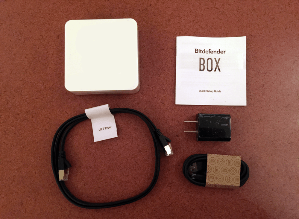 Contents of the Bitdefender BOX: Clockwise from top left. The BOX, Quickstart Guide, USB/AC converter, USB/Mini USB power supply, CAT 6 cable. Image: Rory Bristol