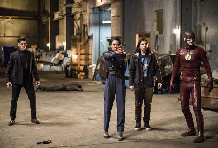 """The Flash -- """"Welcome to Earth-2"""" -- Image FLA213a_0110b -- Pictured (L-R): Michael Rowe as Floyd Lawton, Candice Patton as Earth 2 Iris West, Carlos Valdes as Cisco Ramon, and Grant Gustin as The Flash -- Photo: Diyah Pera/The CW -- �© 2016 The CW Network, LLC. All rights reserved."""