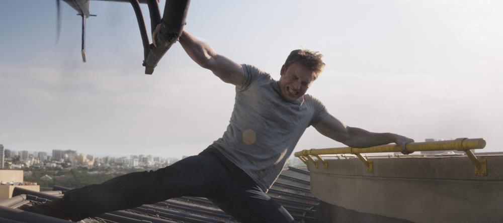 Steve Rogers (Chris Evans) captures a helicopter, and the hearts of a few GeekMoms... Photo Credit: Zade Rosenthal © Marvel 2016