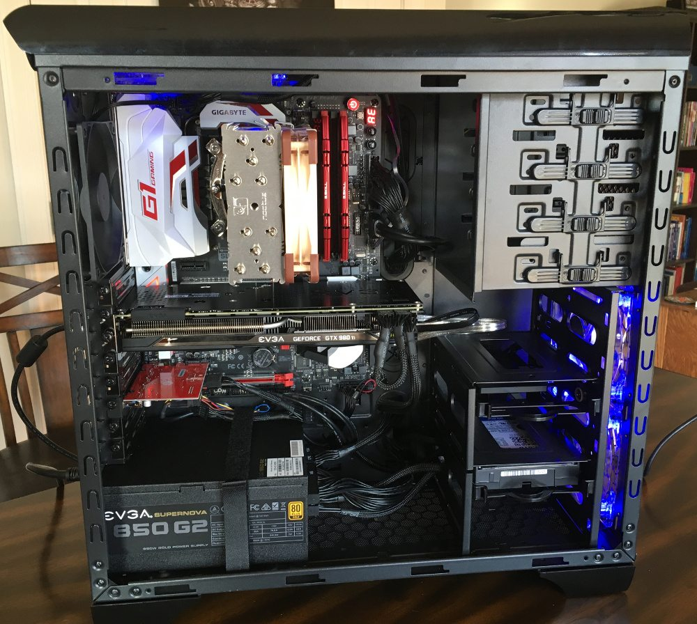 All components installed in a PC tower, with the side cover off to show the neat and tidy cable routing.