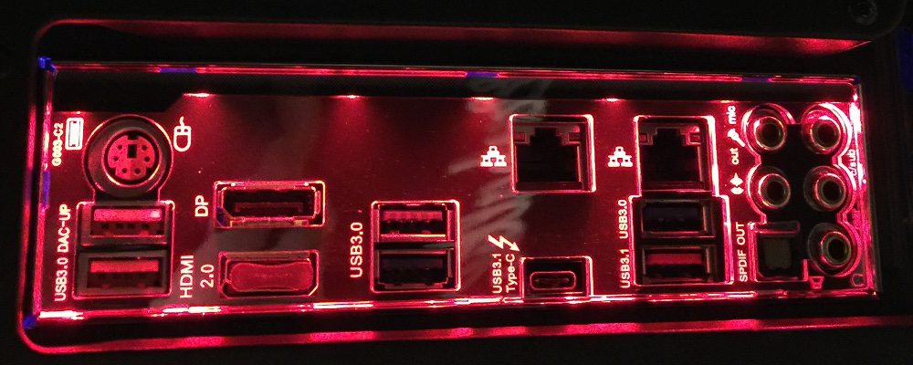 Shows the panel on the back of a PC where connections are made to the motherboard. This one is backlit with the names of the ports clearly identified.