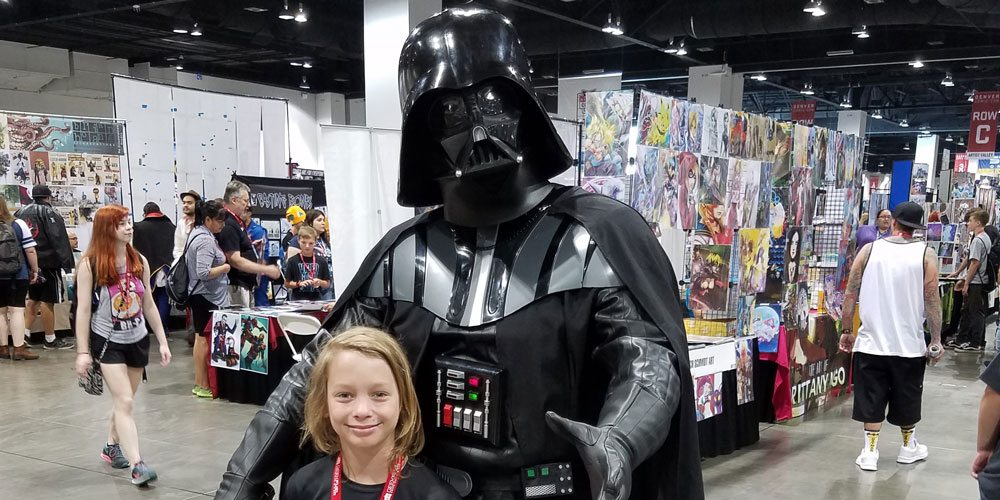 My son and the Dark Lord of the Sith at Denver Comic Con. Image by Rob Huddleston.