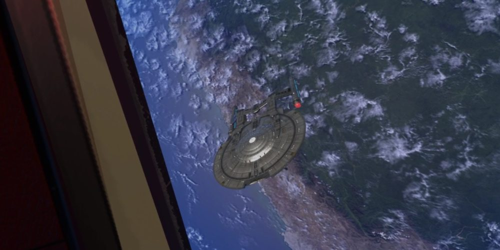 """A view from inside the shuttle in the """"Constitution Class Experience"""" looking at a NX class starship."""