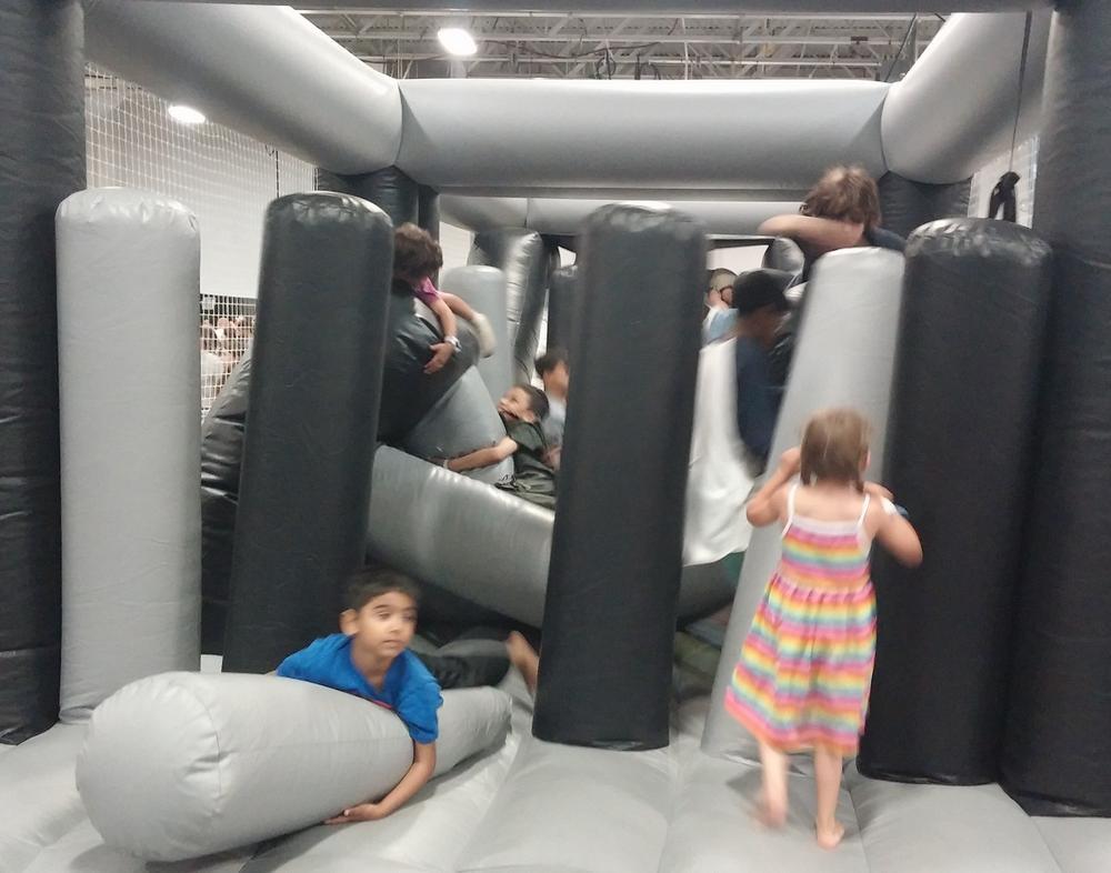 Unbridled kid joy at the bounce house.