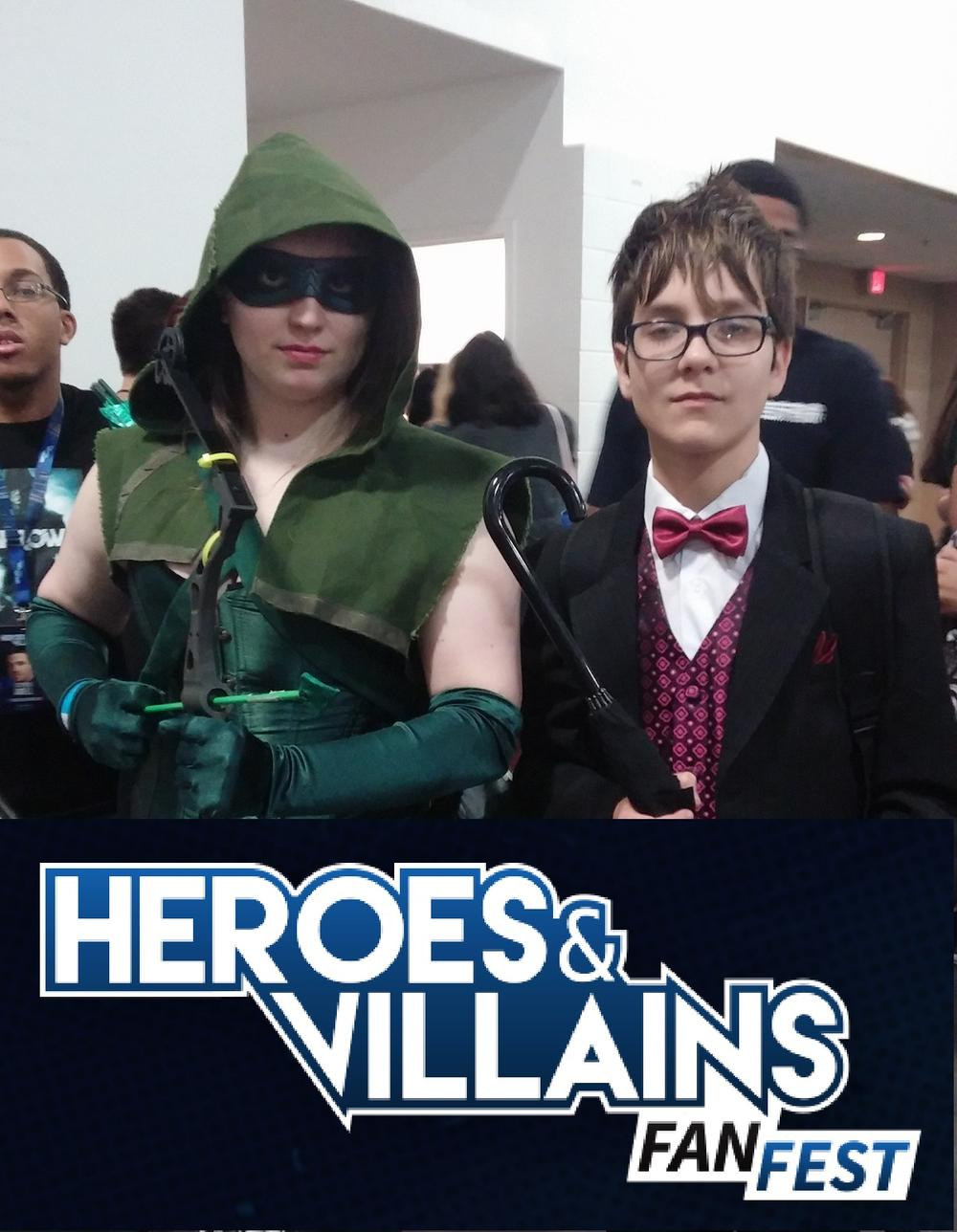 Young cosplayers as 'Green Arrow' and 'Penguin' at Heroes & Villains Fan Fest.