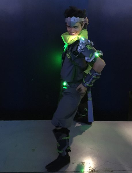 A Genji from the game 'Overwatch', human in costume play (cosplay).