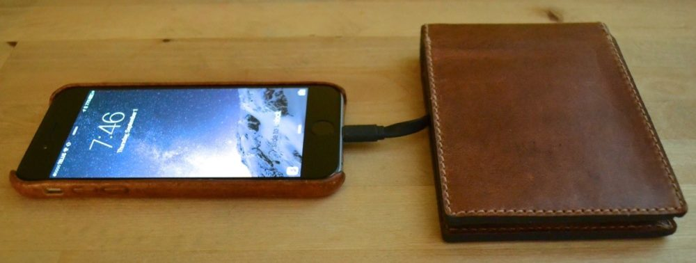 Nomad wallet has hidden iPhone battery charger