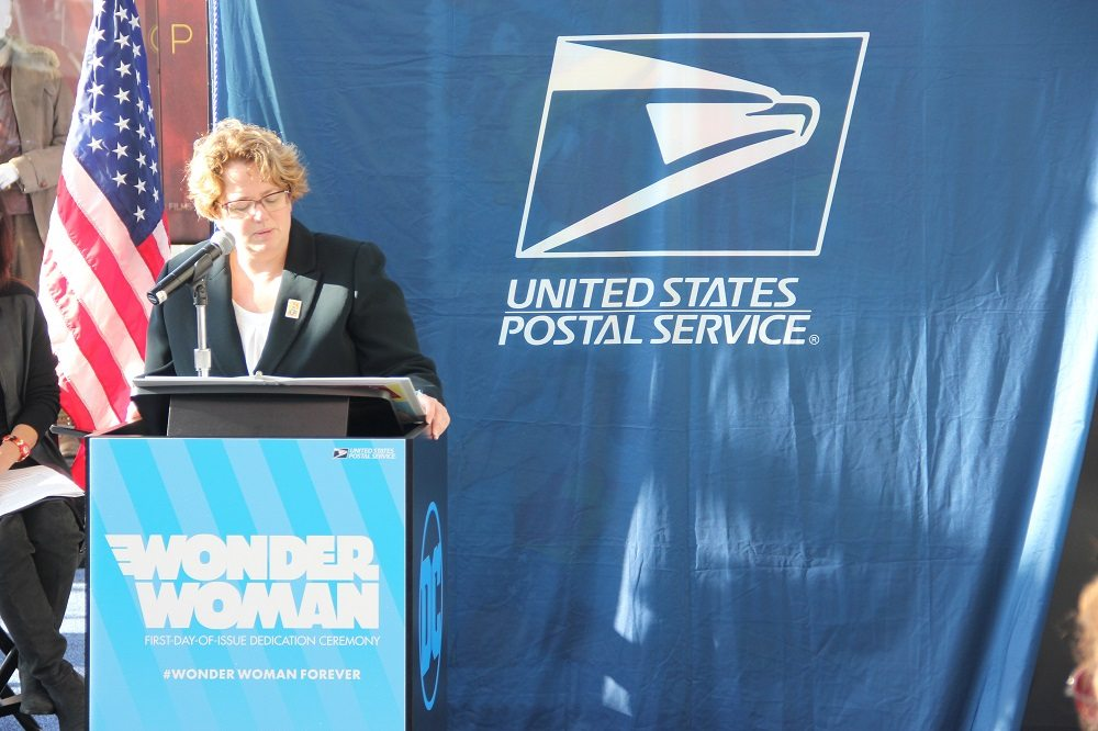 Kristin Seaver of the USPS announcing the stamps. Photo by Jamie Greene.