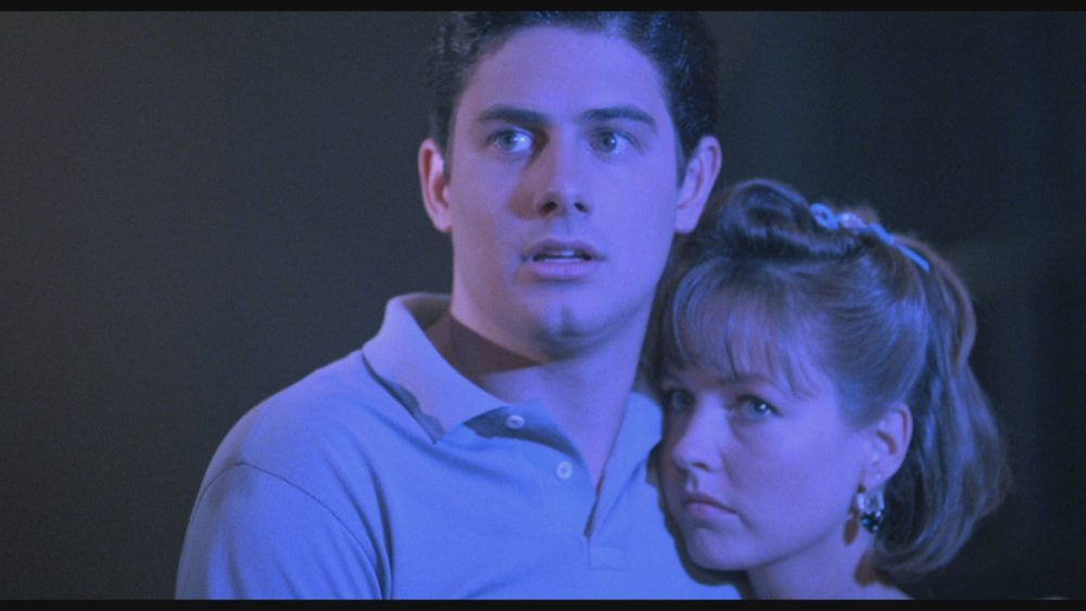 """From left to right: Zach Galligan (""""Mark,"""" left) and Deborah Foreman (""""Sarah,"""" right) star in Lionsgate Home Entertainment's WAXWORK."""