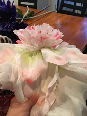 The center of the large silk flower needed to go to make room for the eyeball. Photo by author
