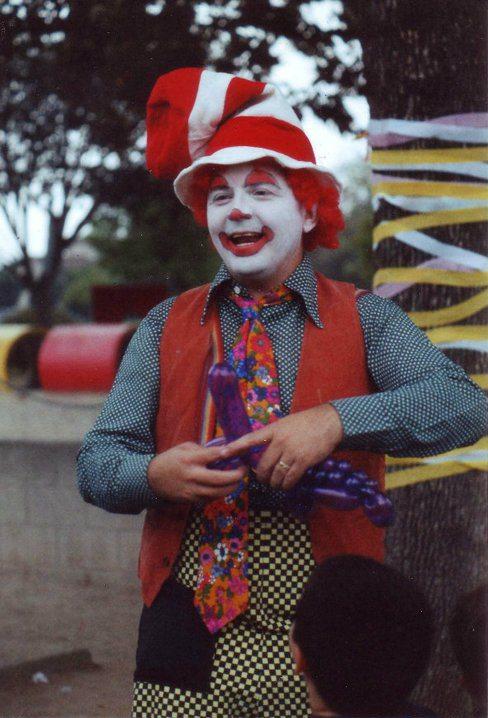 Jim MacQuarrie as a clown twisting balloon animals