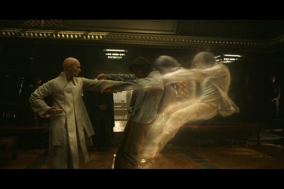The Ancient One (Tilda Swinton) shoves Dr. Strange (Benedict Cumberbatch) out of his body.