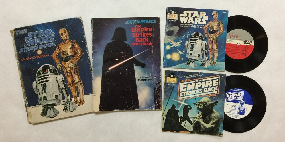 The full-color photograph books from 'Star Wars' and 'Empire Strikes Back' alongside the two read-along books, with 33 1/3 RPM records showing.