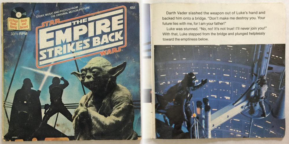 """The cover to the Buena Vista read-along of The Empire Strikes Back, showing Luke fighting Darth Vader with Yoda looking on. On the right side of the image is a page from the book where Luke exclaims """"I'll Never Join You""""."""