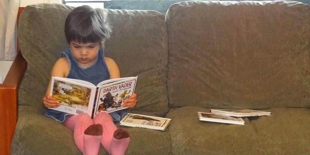 Toddler reading Darth Vader & Son