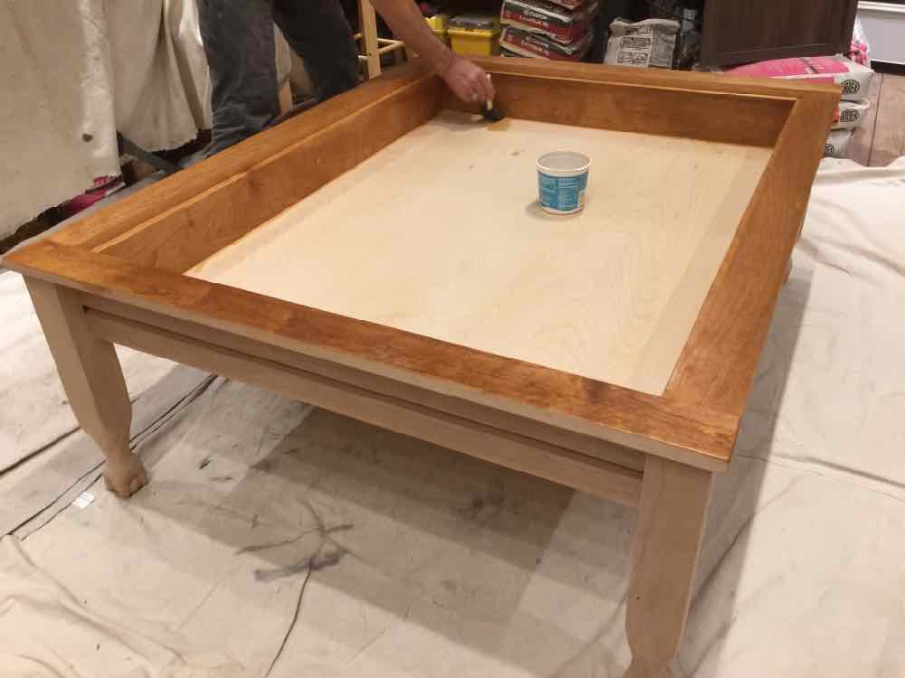 Applying finish to the gaming table