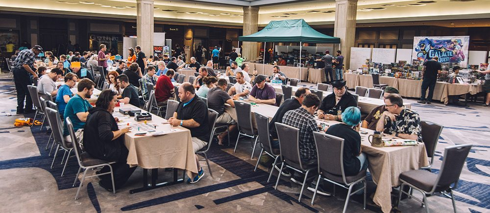 A portion of the large tabletop gaming area. Photo copyright: Juan Jusino